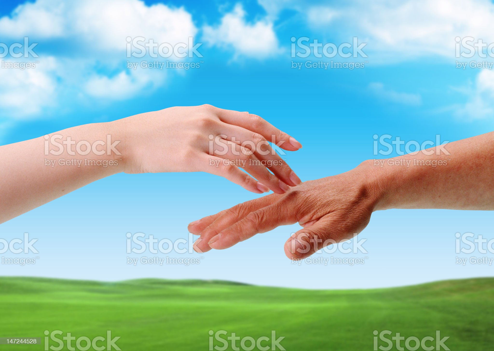 The Touch Of Hands Between Old And Young royalty-free stock photo