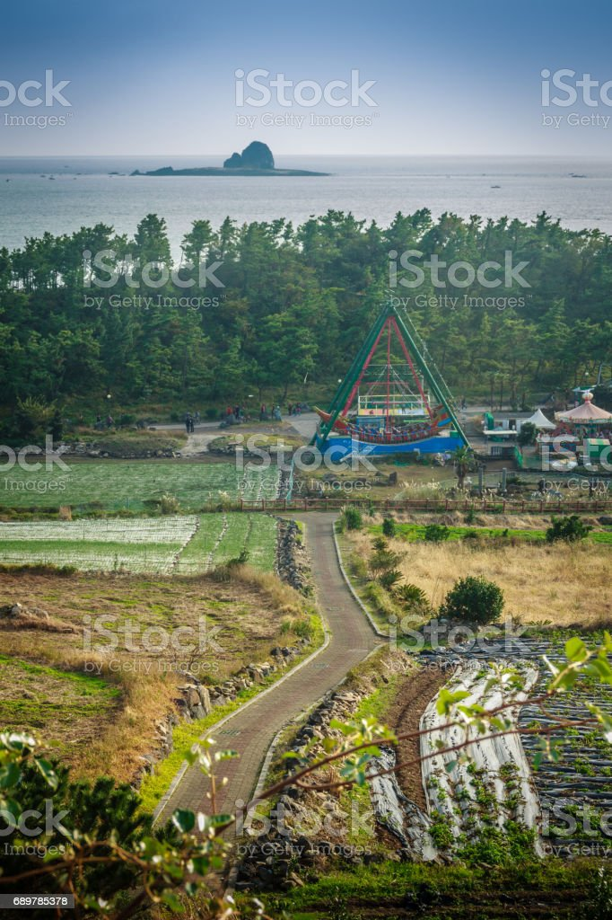 Jeju Island, KOREA - NOVEMBER 12: The tourist visited Sanbanggulsa temple that located on Sanbangsan Mountain. On the way to the cave, with the temple in it you have multiple buildings - 12 NOVEMBER 2016 stock photo