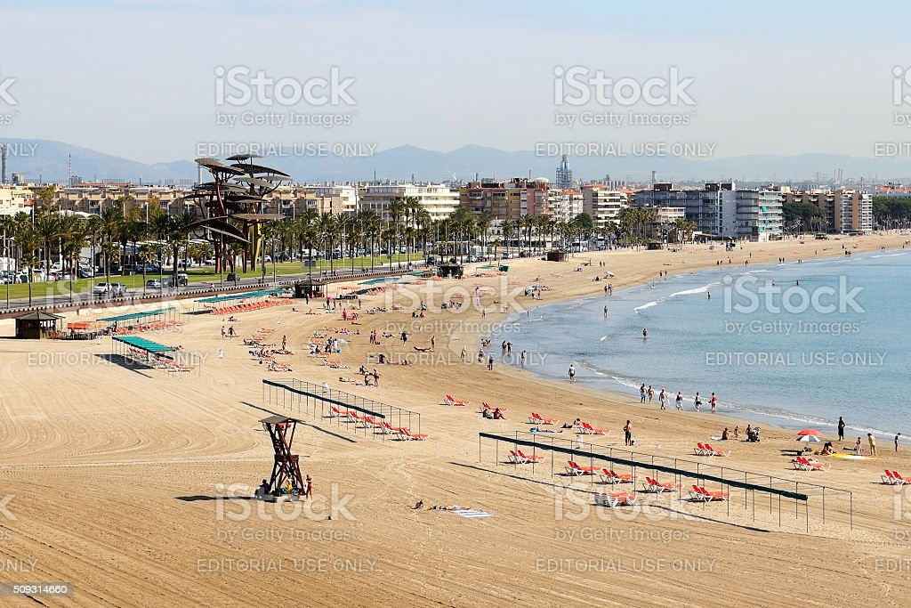 The tourists enjoiying their vacation on the beach stock photo