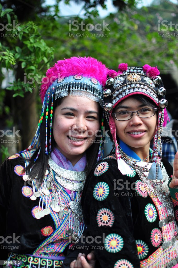 The tourists wear tribal costumes of Miao Tribal to enjoy for take photo, Thailand stock photo