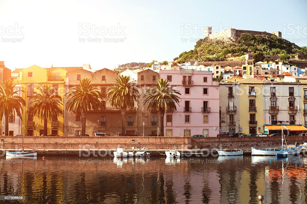 The town of Bosa and the old castle at sunset stock photo