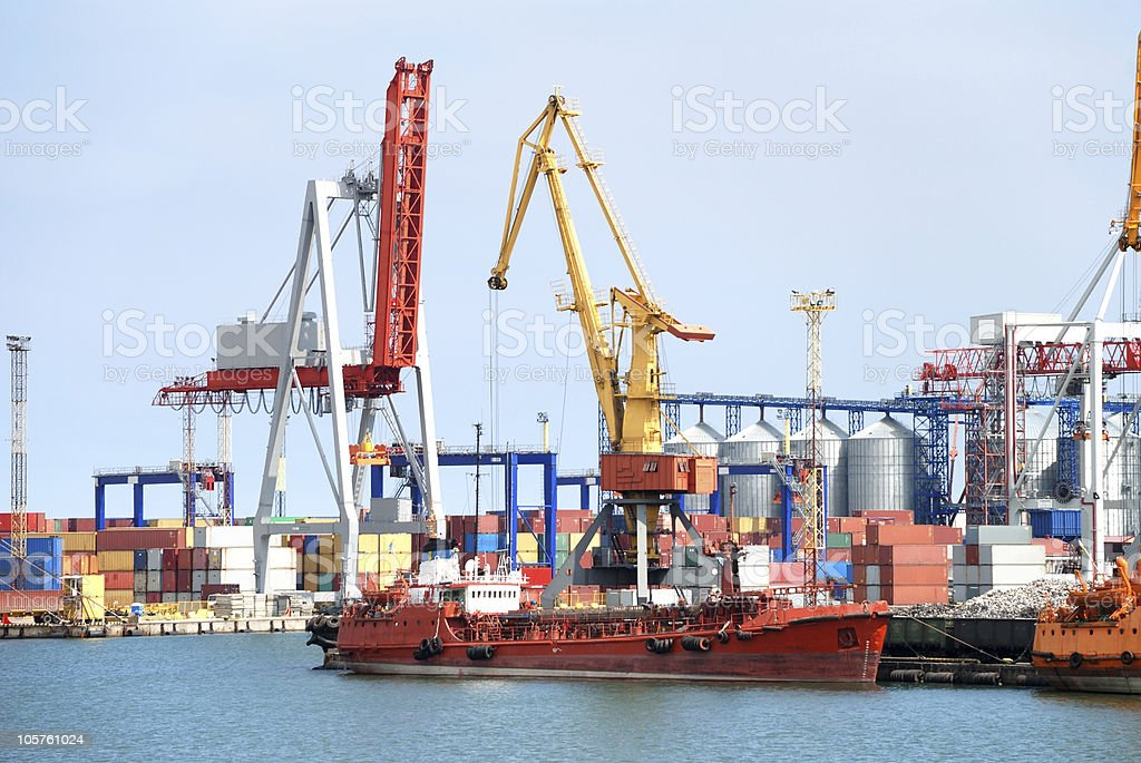 The trading seaport with cranes, cargoes and ship stock photo