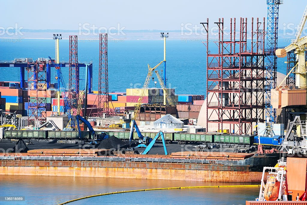 The trading seaport with cranes, cargoes and ship royalty-free stock photo