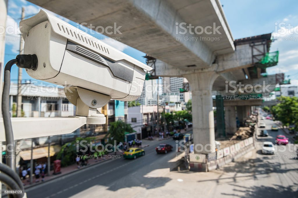 The traffic security CCTV camera operating on road detecting tra stock photo