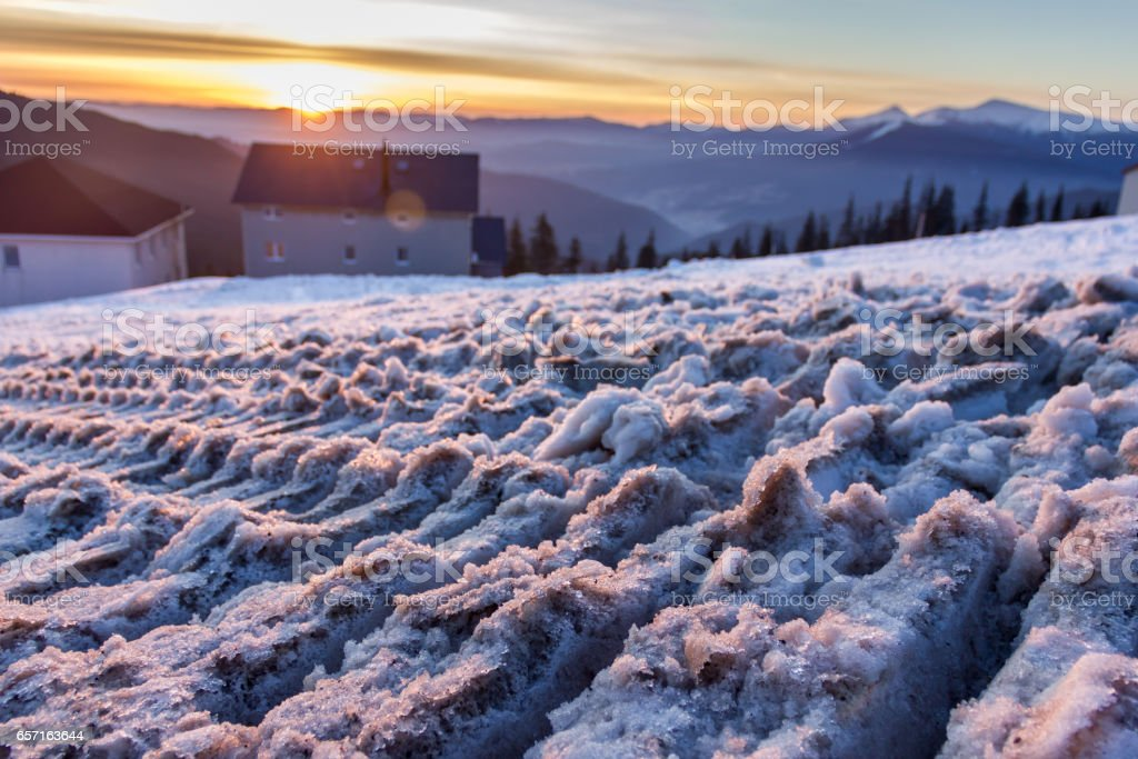 The trail from snowmobile in the Carpathians mountains stock photo