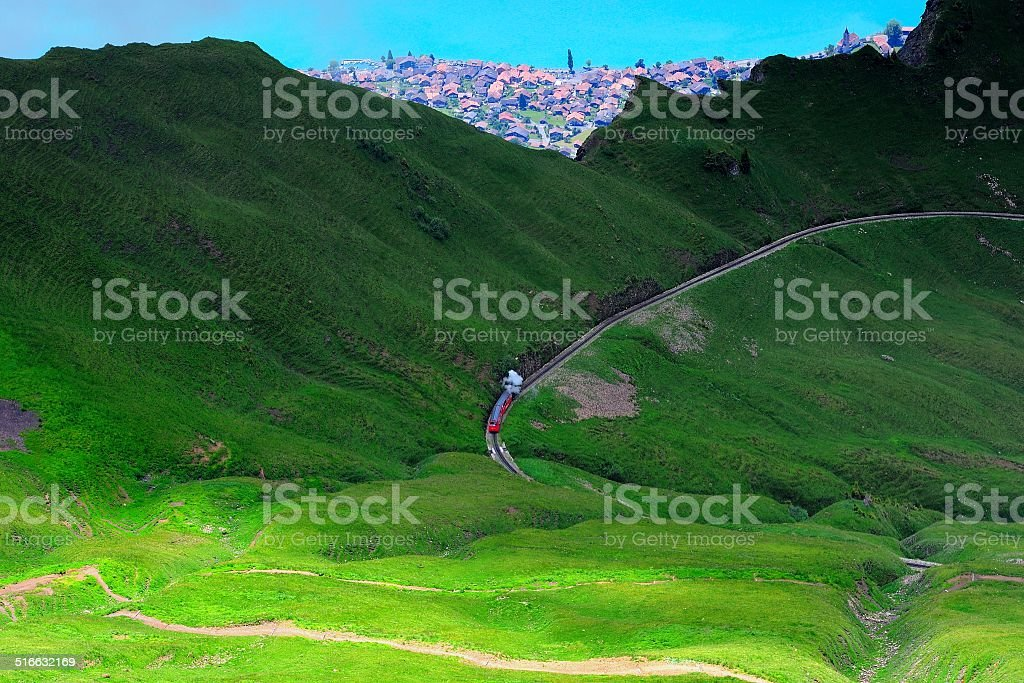 The train goes through a ridge in Switzerland 02 stock photo