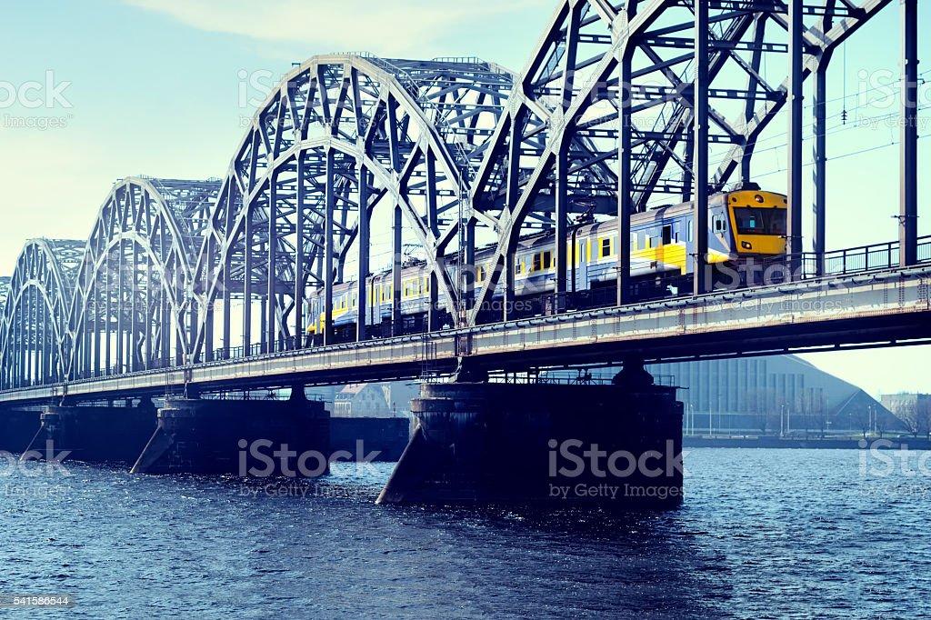 The train on a railway bridge in Riga stock photo