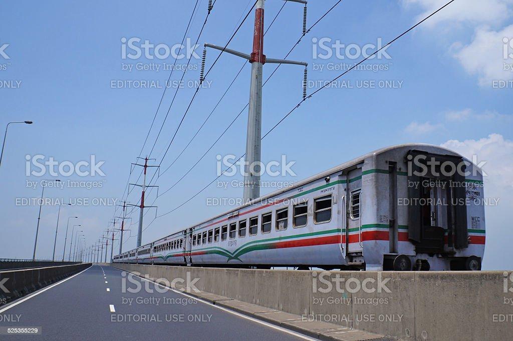 The train on Jamuna Multi Purpose Bridge stock photo