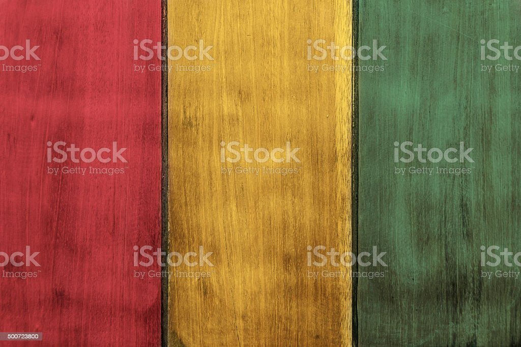 The Tricolour Flag Of Guinea Painted On Wooden Boards stock photo