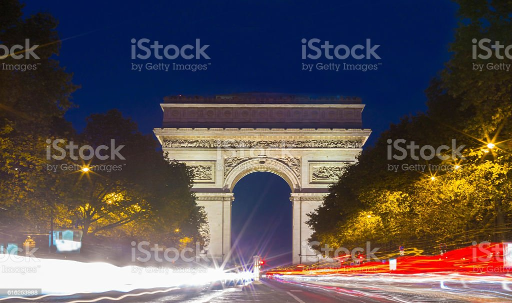 the Triumphal Arch at night, Paris, France. stock photo