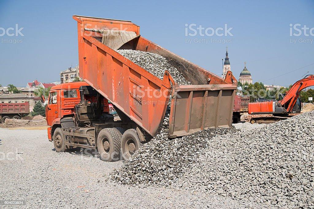 The truck empties gravel road construction stock photo