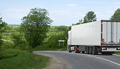 The truck on asphalt road.