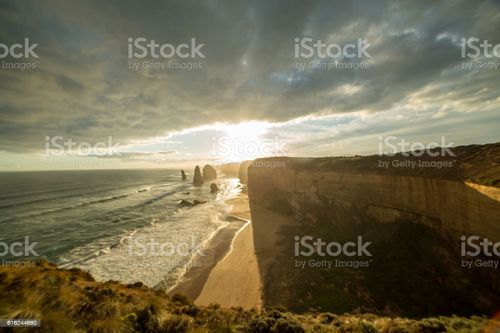 The Twelve Apostles sea rocks at sunset under dramatic sky stock photo
