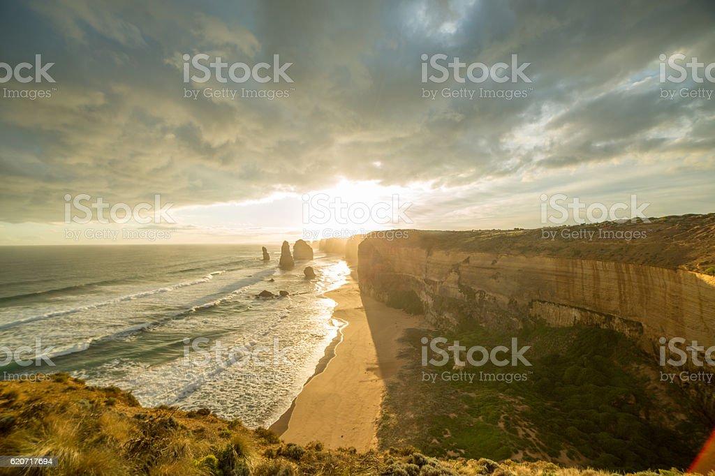 The Twelve Apostles sea rocks at sunset under dramatic sky stock photo