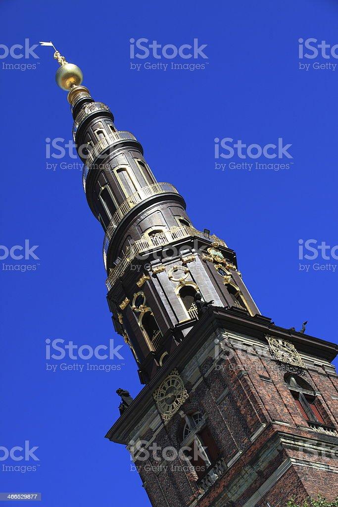 The Twisted tower of  Vor Frelser Kirke Chruch, Copenhagen royalty-free stock photo