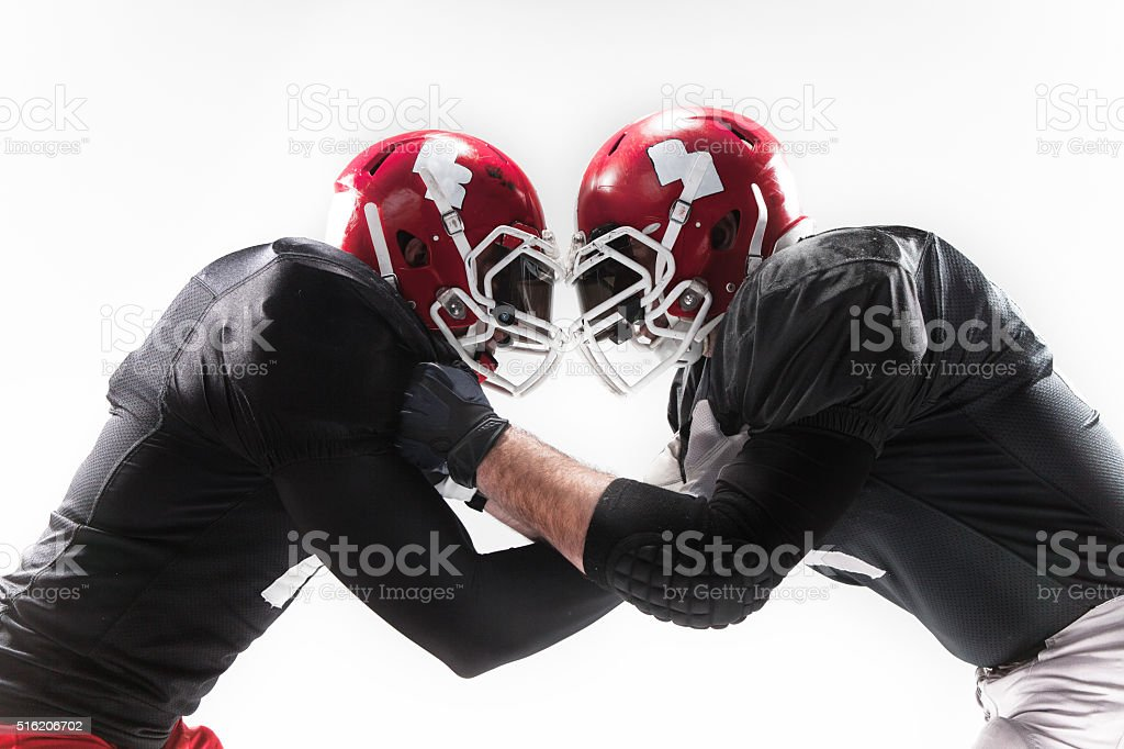 The two american football players fighting on white background stock photo