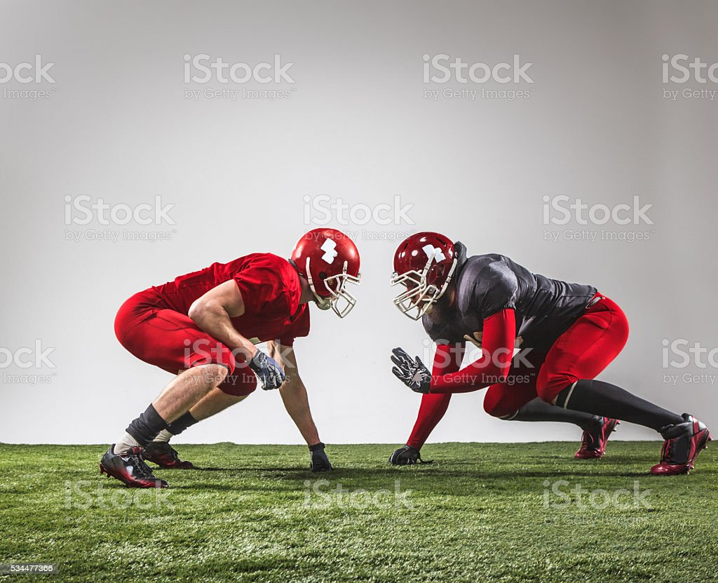 The two american football players in action stock photo