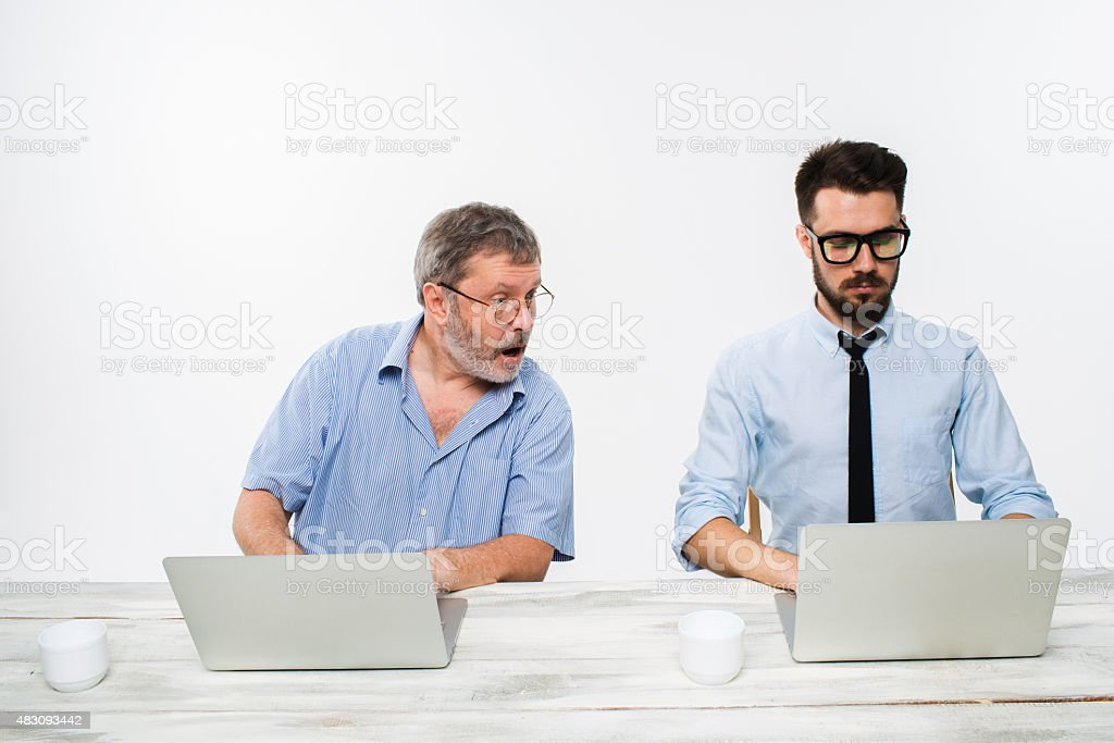 The two colleagues working together at office on white background stock photo