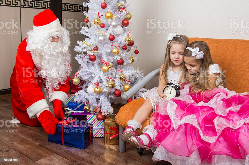 The two girls did not wait for Santa Claus and stock photo