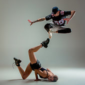 The two young girl and boy dancing hip hop in