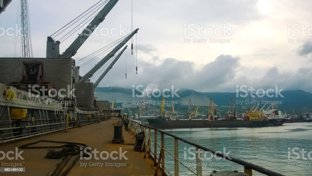 The type of port cranes in the background of the landscape of the port and port area stock photo