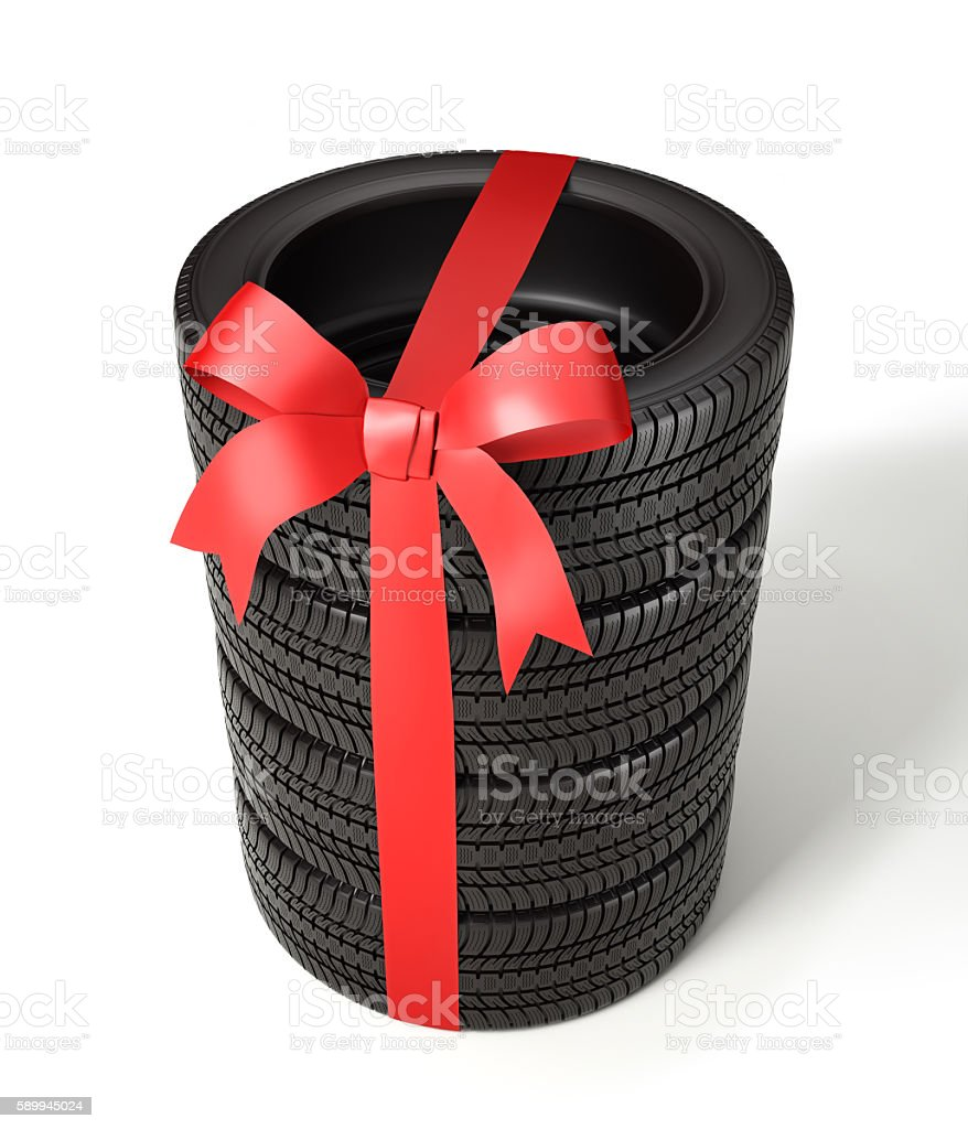 the tyres are packaged as a gift, wrapped red ribbon stock photo