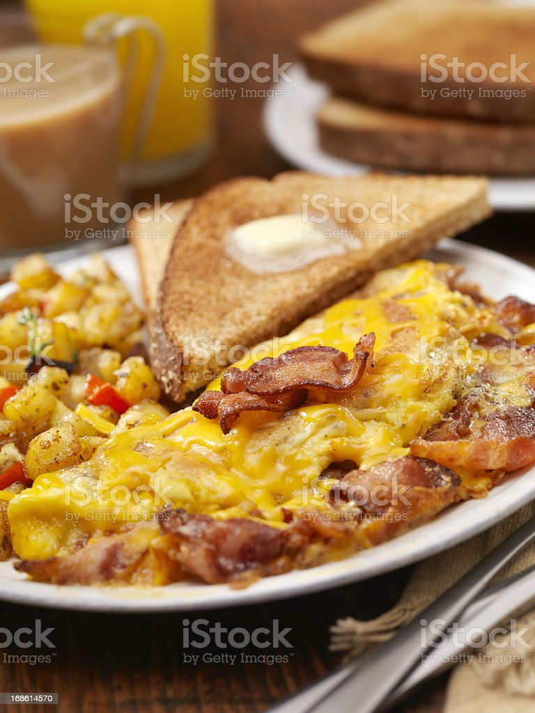 The Ultimate Bacon And Cheddar Cheese Omelette royalty-free stock photo