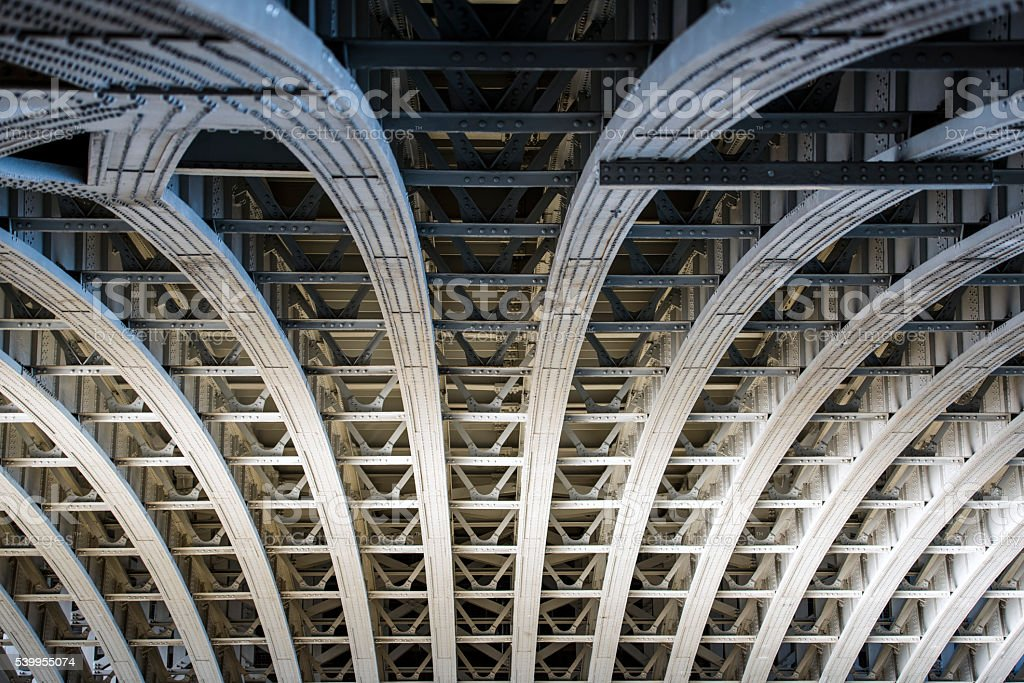The underside of a bridge in London stock photo