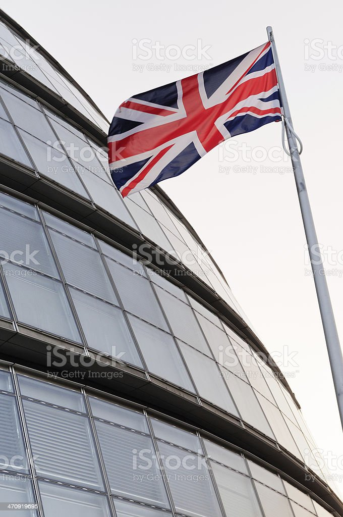 The Union flag and London City Hall royalty-free stock photo