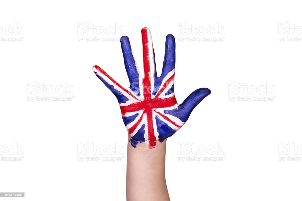The United Kingdom flag on a hand. Travelling to The stock photo