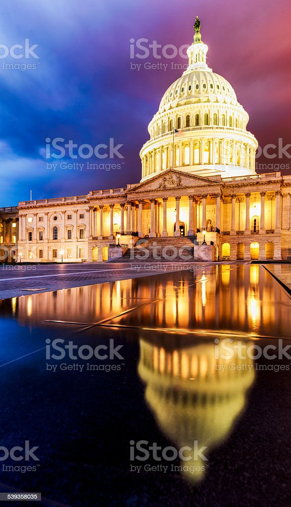 The United States Capitol Building under Dramatic Sky stock photo