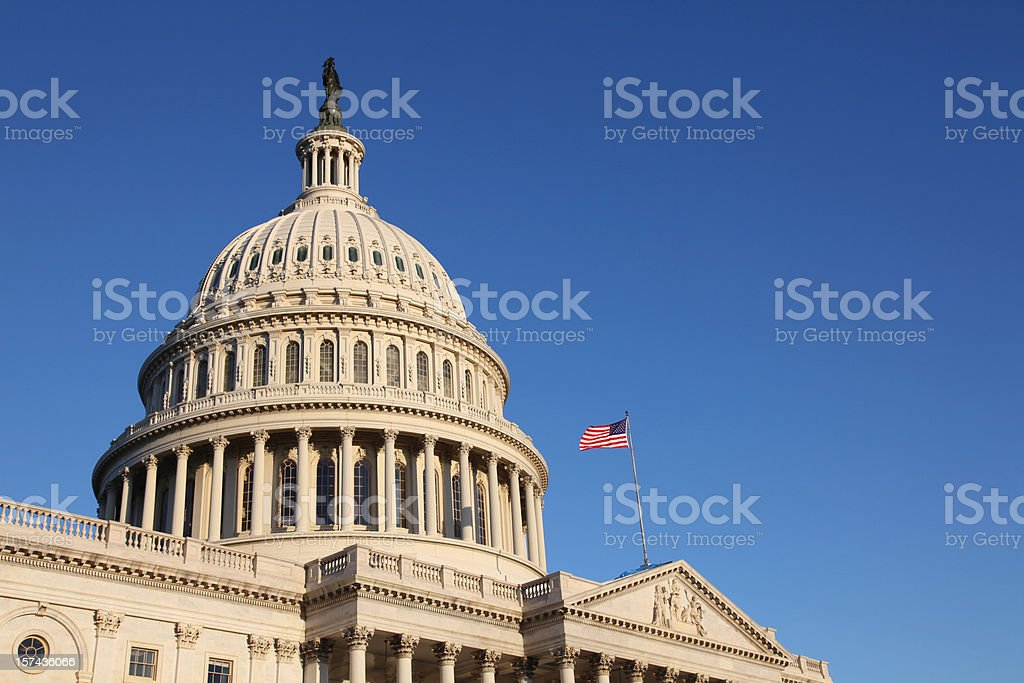 The United States Congress with flag stock photo