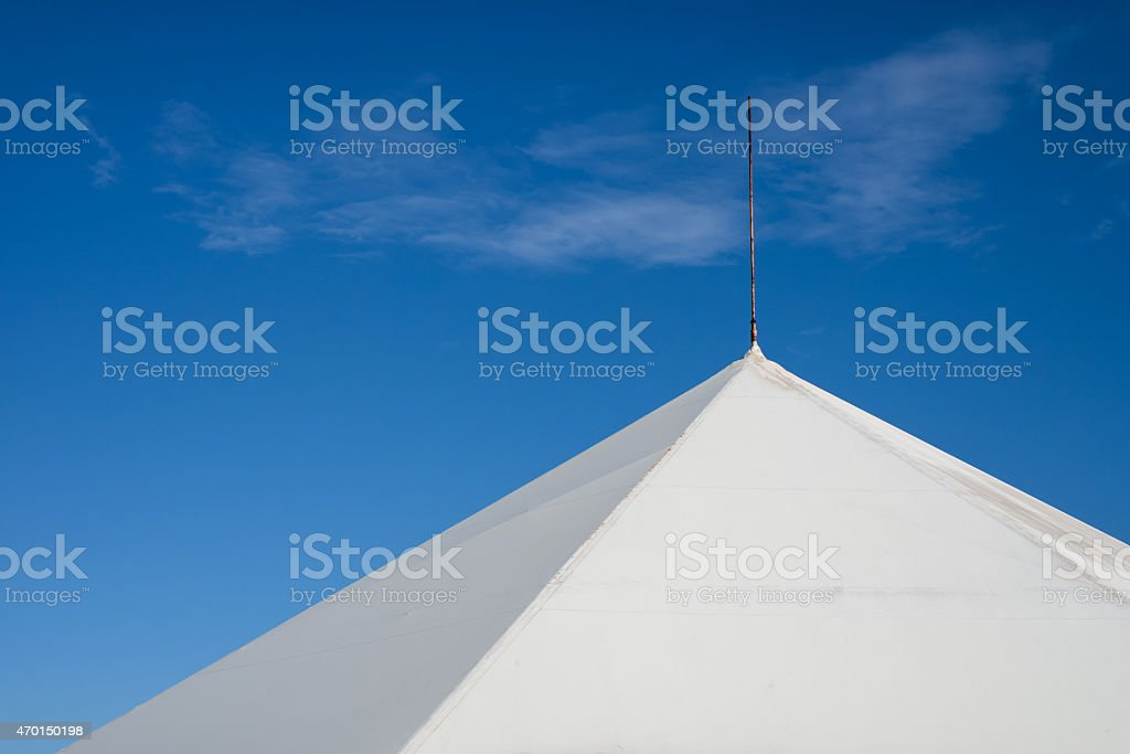 The upper part of the tent against the blue sky stock photo