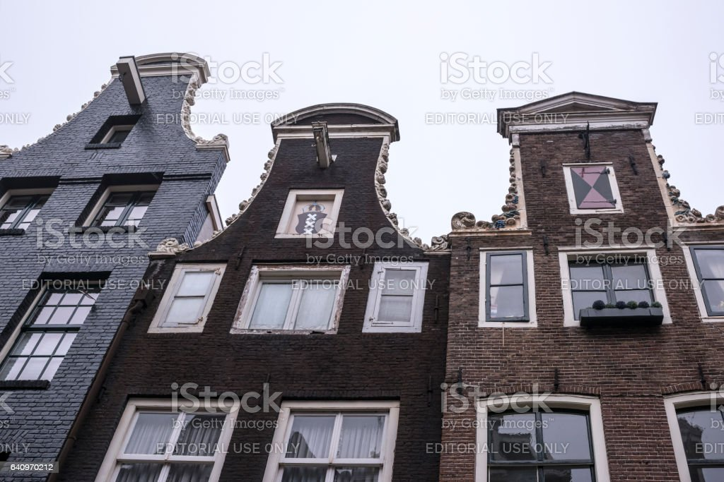 The upper parts of buildings, visible console for lifting stock photo