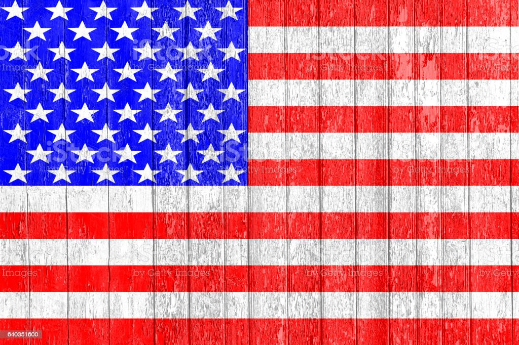 The USA flag painted on a wooden fence stock photo