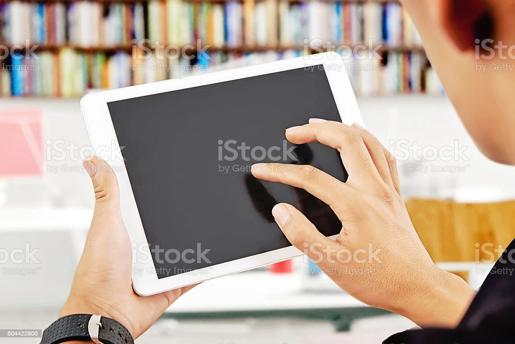 The use of digital flat panel computer. stock photo