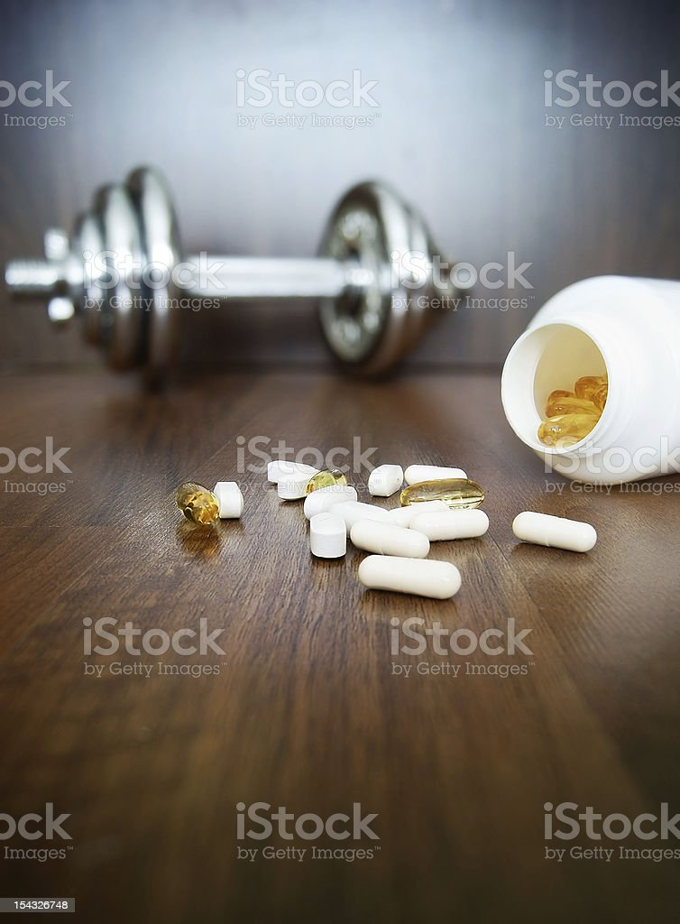 The use of medications and supplements in weightlifting royalty-free stock photo