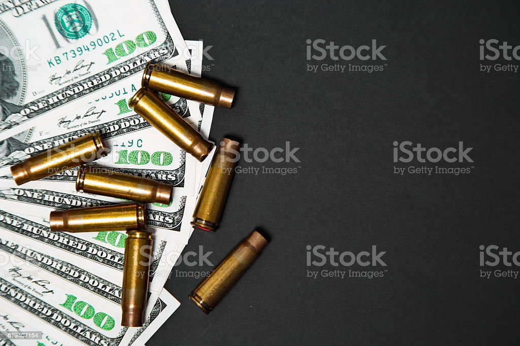 The used shell casings is on a money stock photo