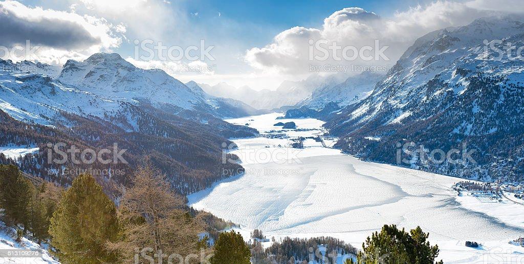 The valley of Engadine St. Moritz Switzerland with frozen lakes stock photo