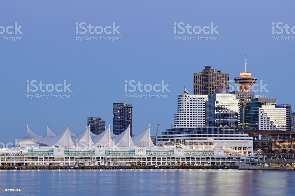 The Vancouver skyline reflected off a lake in the evening royalty-free stock photo