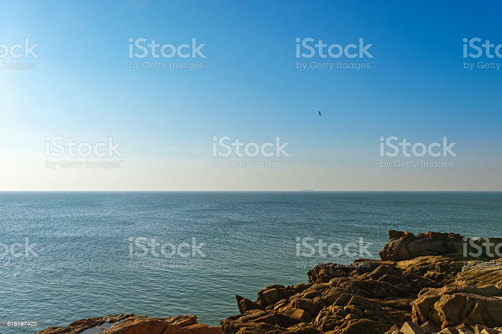 The vast expanse of the ocean and coastal reef stock photo