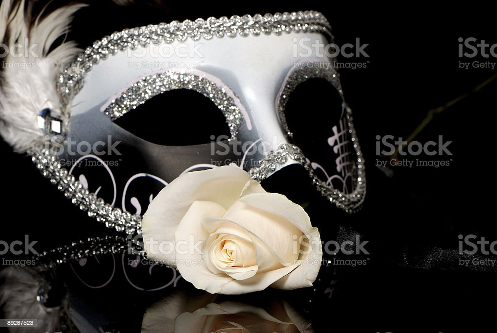 The Venetian mask and flower on a black background royalty-free stock photo