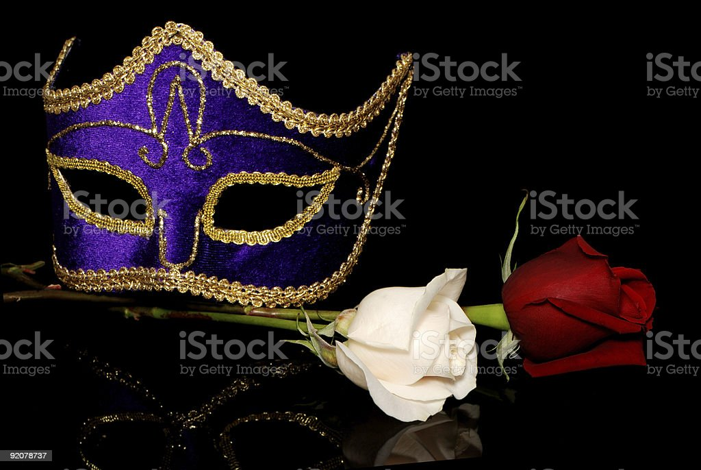 The Venetian mask and flowers on a black background royalty-free stock photo