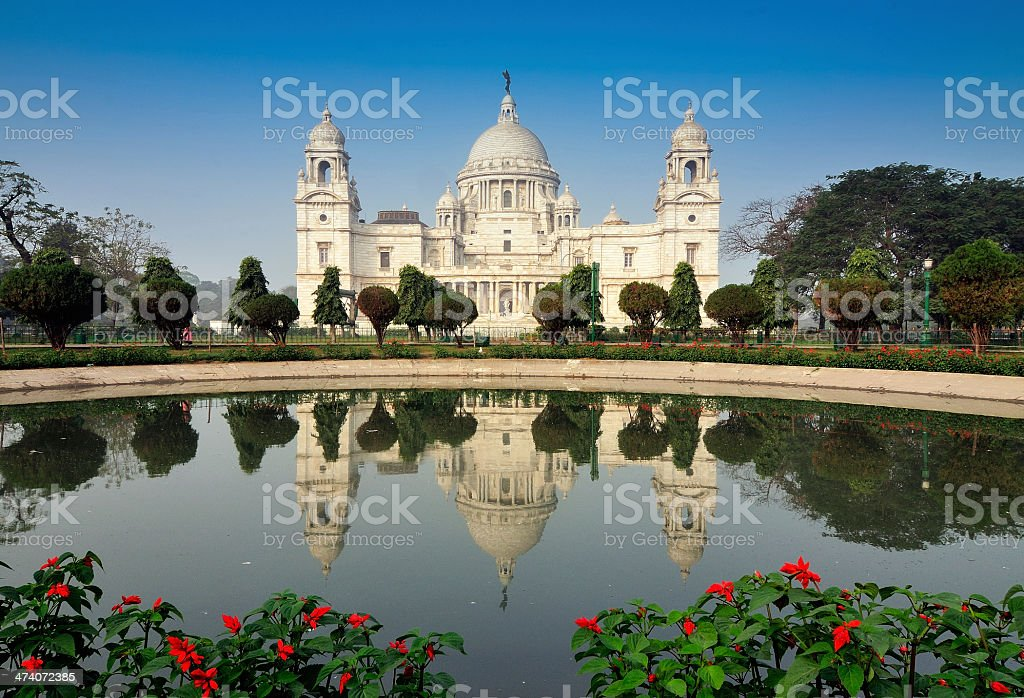 The Victoria Memorial reflected on water in Kolkata, India stock photo