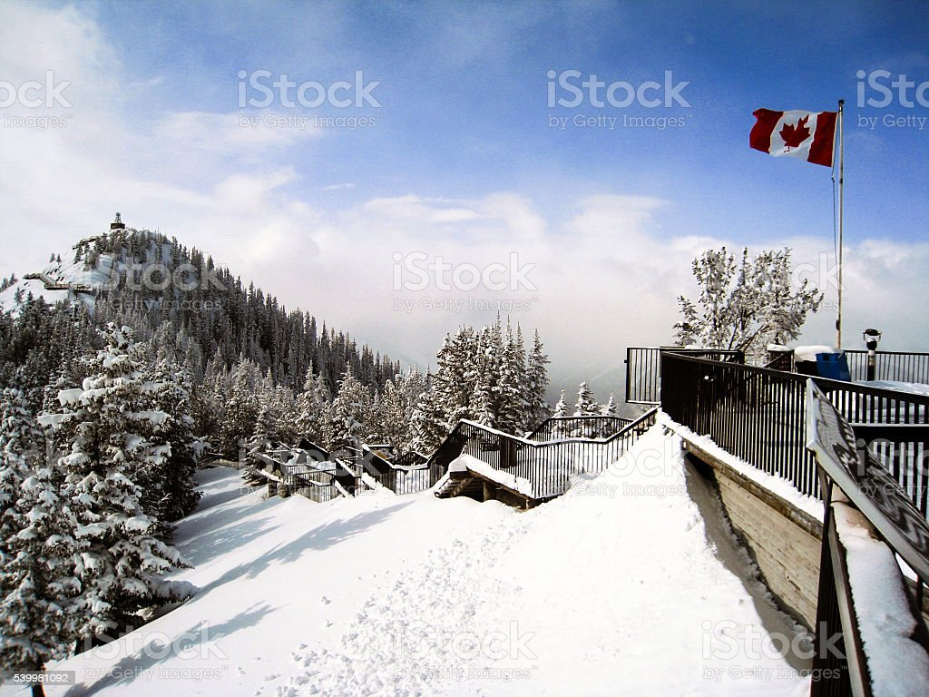 The view from Banff gondola platform with snow stock photo