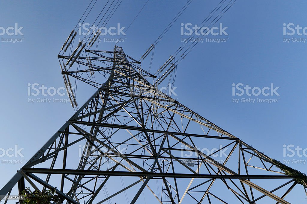 Power view of an electricity pylon with blue sky stock photo