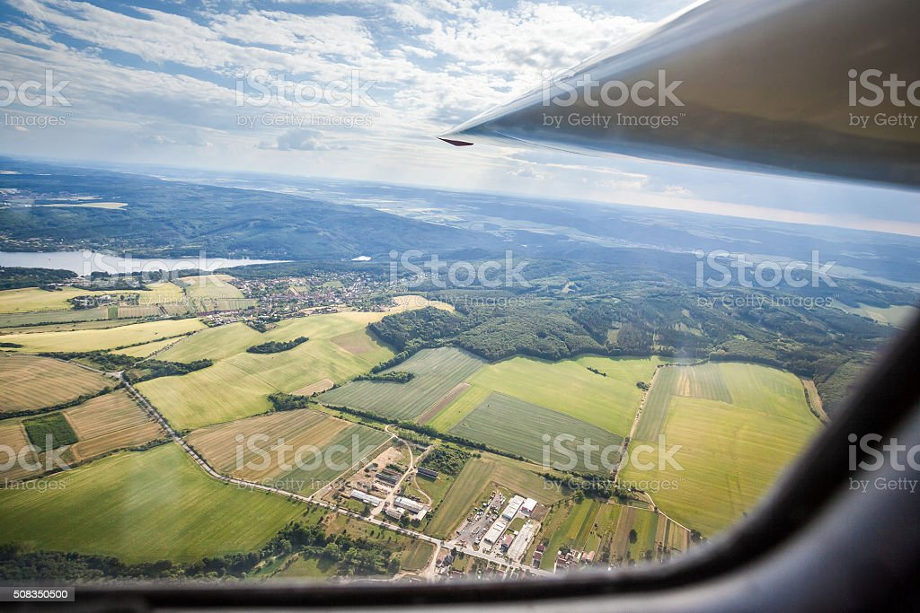 the view from the cockpit of a glider stock photo
