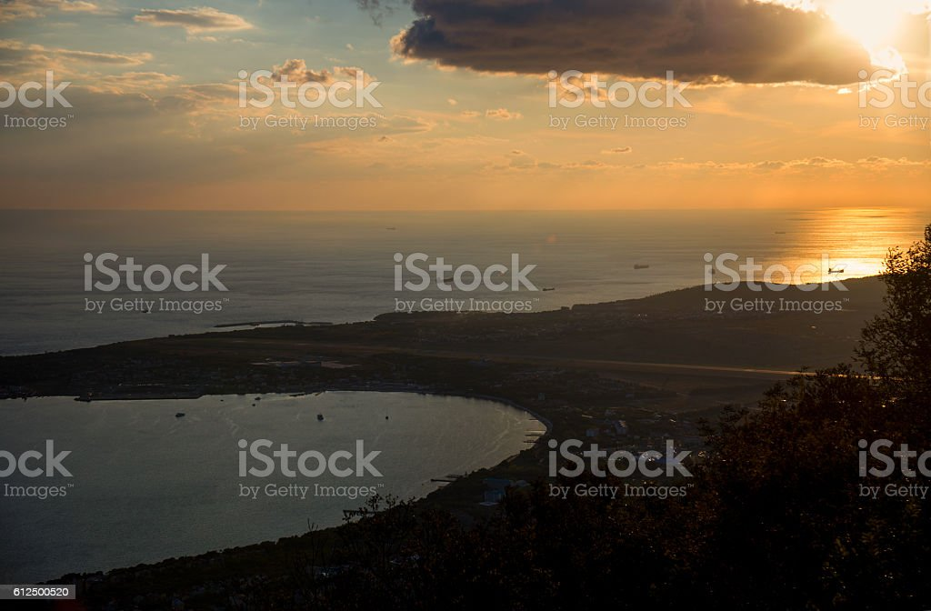 The view of the sunset over the sea stock photo