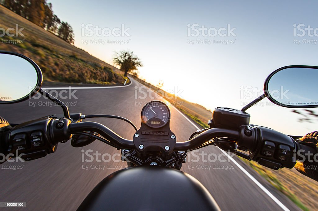 The view over the handlebars of motorcycle stock photo