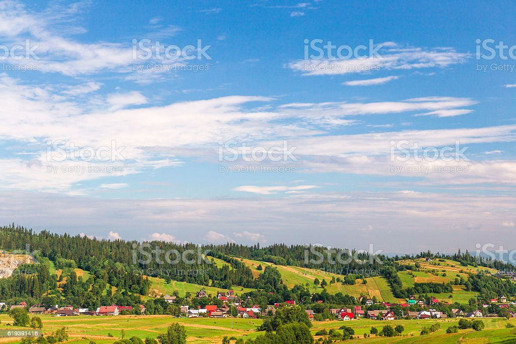 The village in the mountains and meadows. Poland, Eastern Europe. stock photo